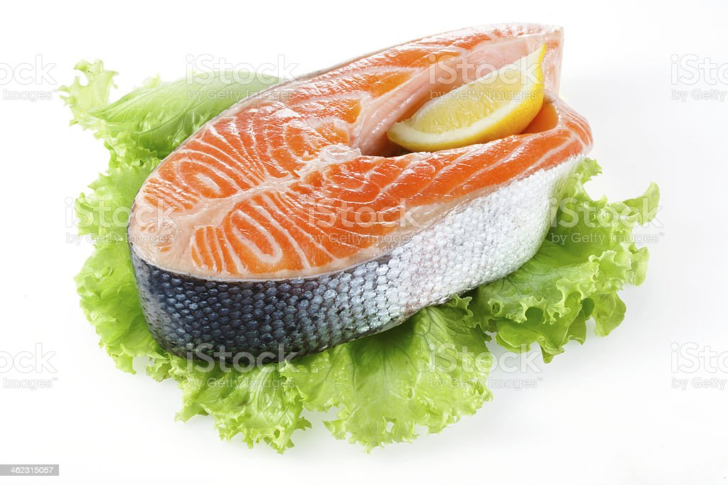 Salmon steak with lemon isolated on white royalty-free stock photo