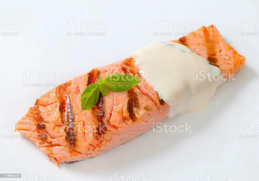 Salmon steak with mayonnaise dressing royalty-free stock photo