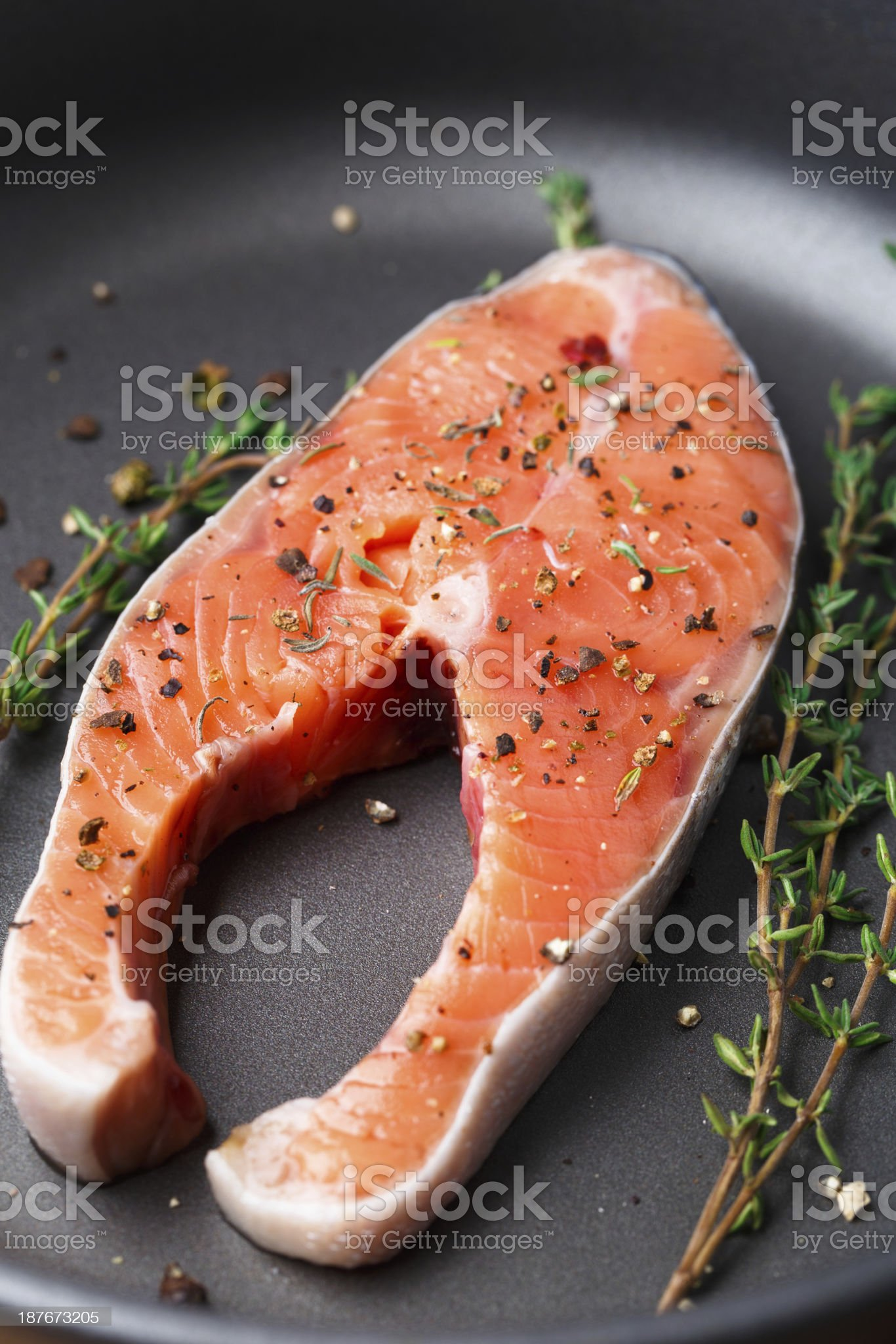 Salmon steak with thyme and pepper royalty-free stock photo