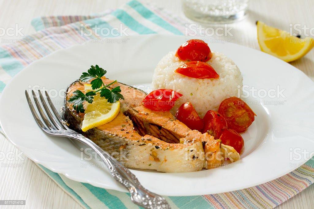 Salmon steak with tomato sauce, selective focus stock photo
