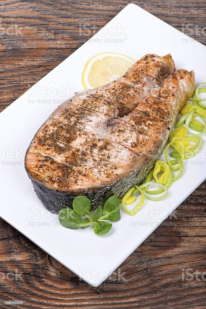 Salmon steak with vegetables cooked on the grill royalty-free stock photo