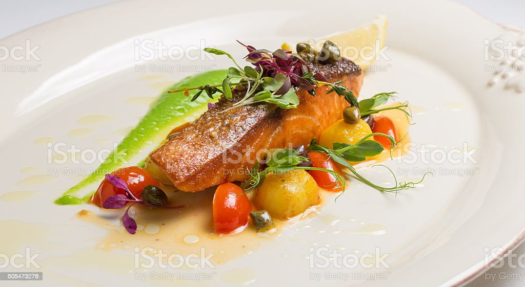 salmon steak with vegetables stock photo