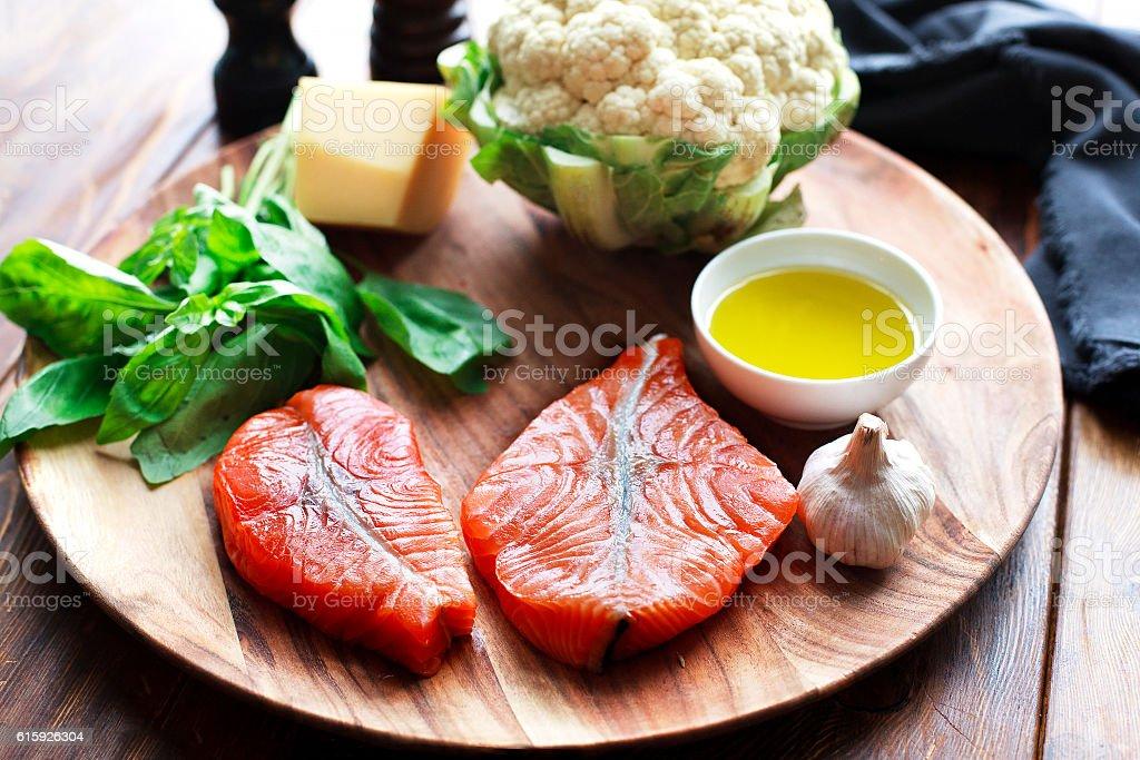 Salmon steaks with fresh ingredients stock photo