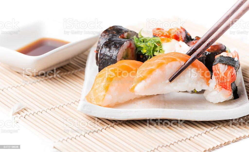 salmon sushi on chopstrick. stock photo