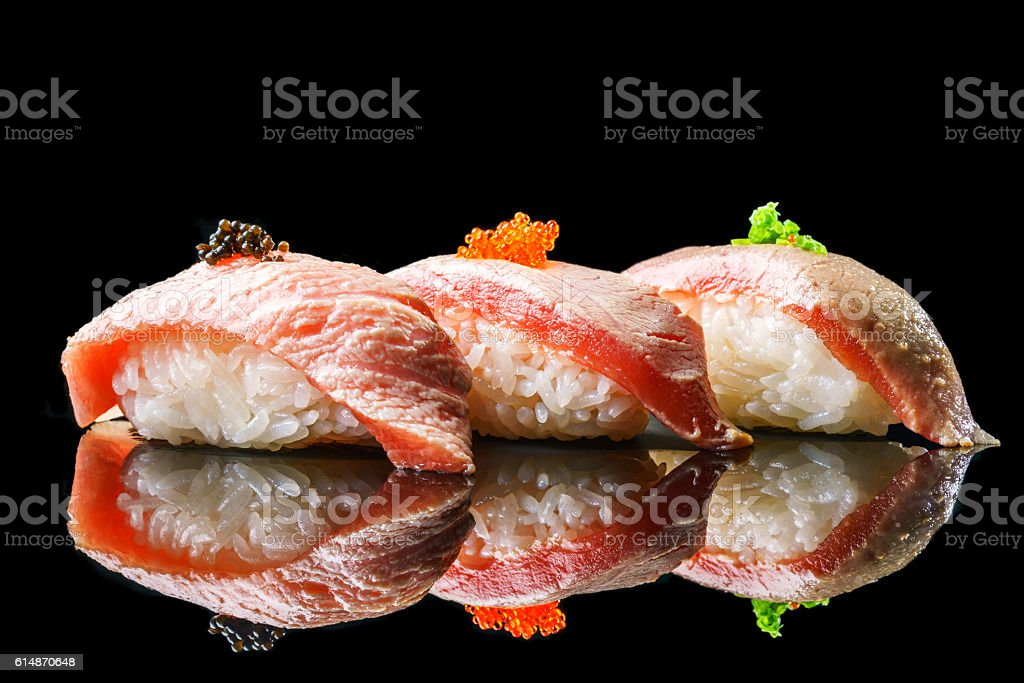 Salmon sushi on the blackbackground stock photo