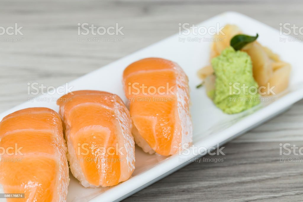 Salmon sushi with wasabi on a dish stock photo