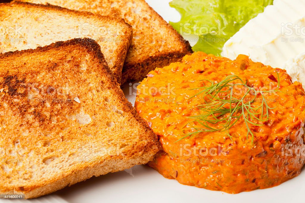 Salmon tartare whit toasted bread butter and letuce. stock photo
