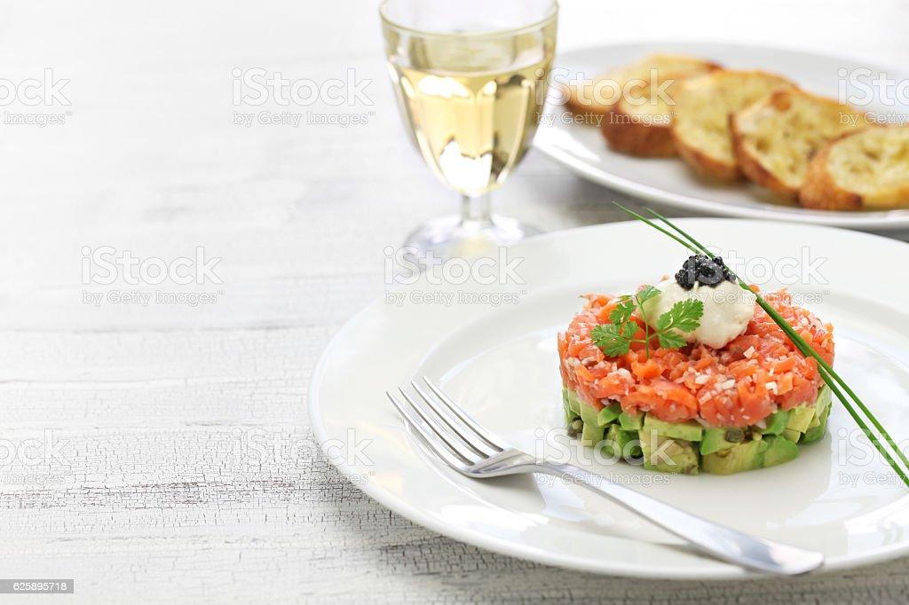 salmon tartare with avocado stock photo