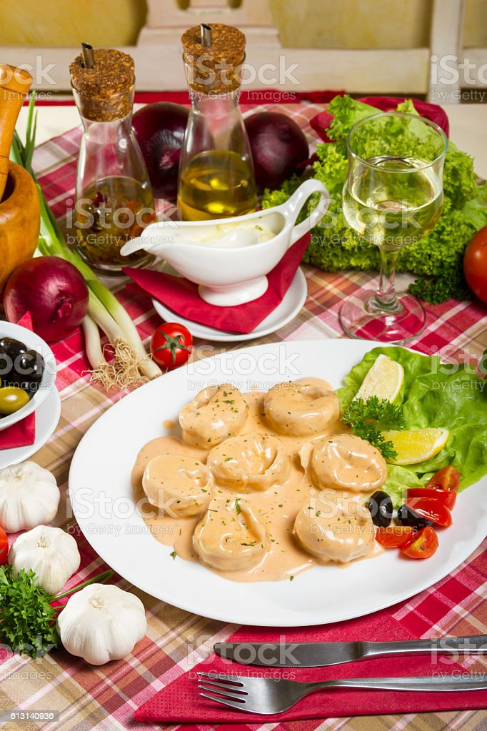 Salmon Tortellini in Sauce Olive Oil and White Wine stock photo
