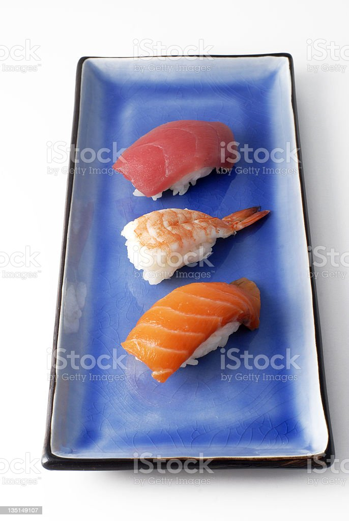 salmon tuna and prawn sushi on a square blue plate royalty-free stock photo
