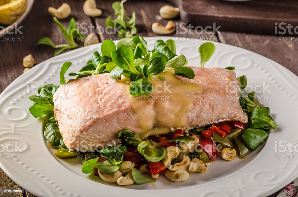 Salmon with hollandaise sauce and salad stock photo