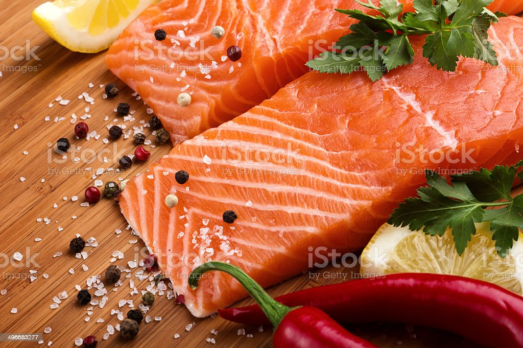 Salmon with lemon and pepper royalty-free stock photo