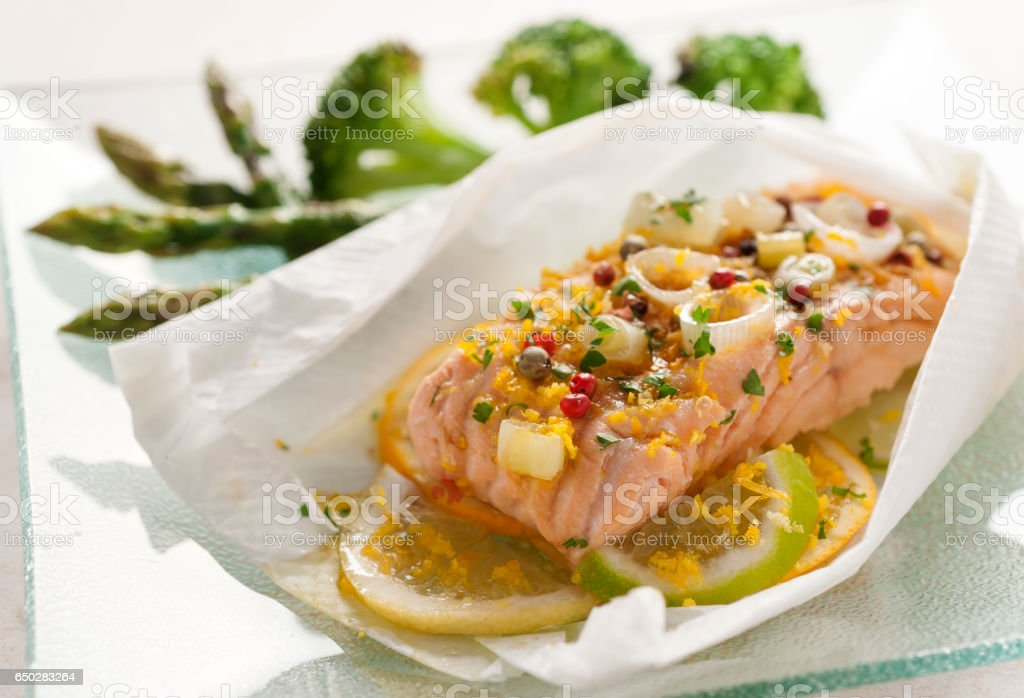 salmon with lemon and vegetables stock photo