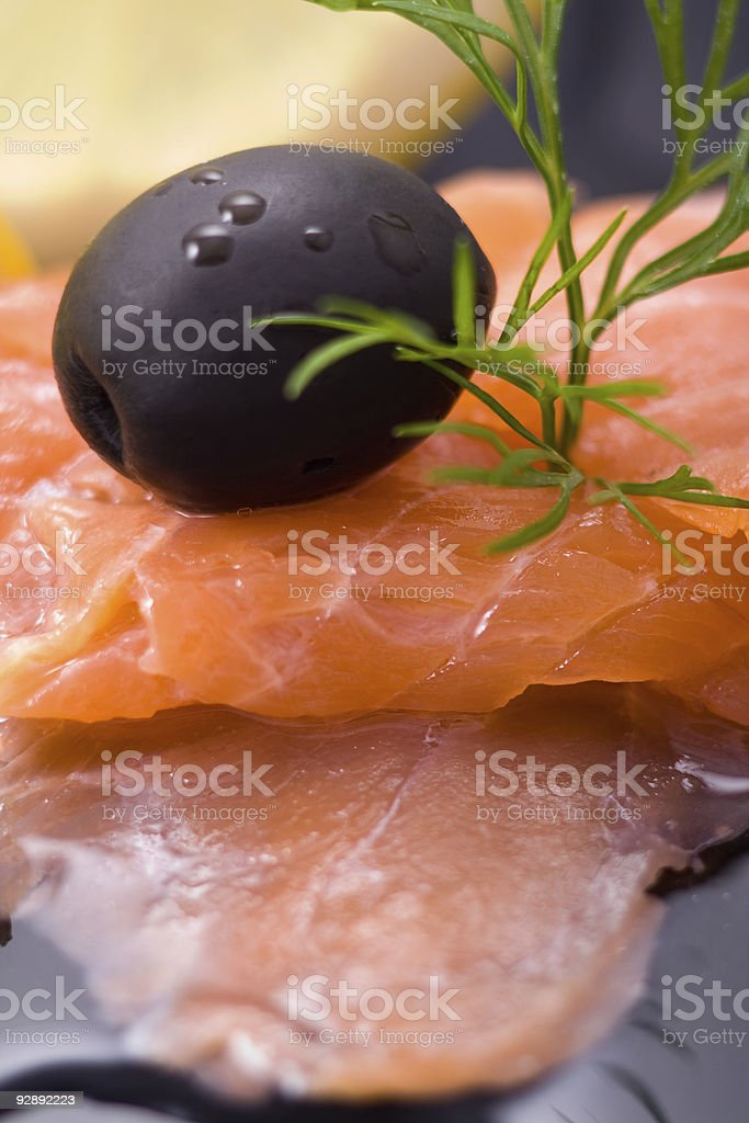 Salmon with lemon, black olive and dill, macro royalty-free stock photo