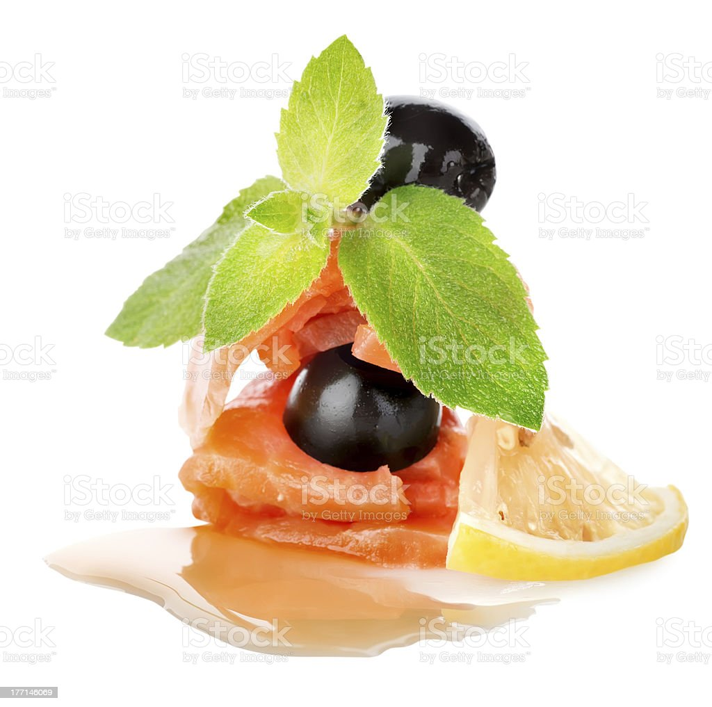 Salmon with lemons and olives royalty-free stock photo