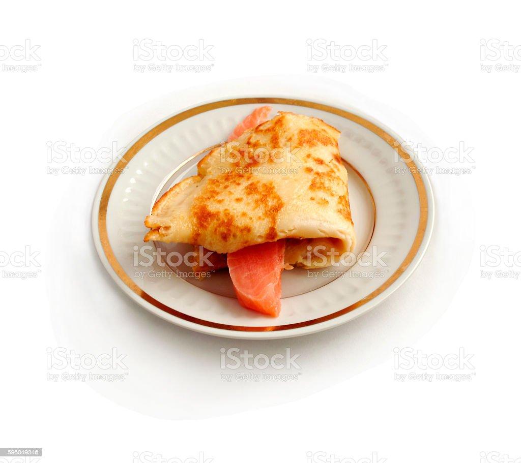Salmon with  pancake on plate. stock photo