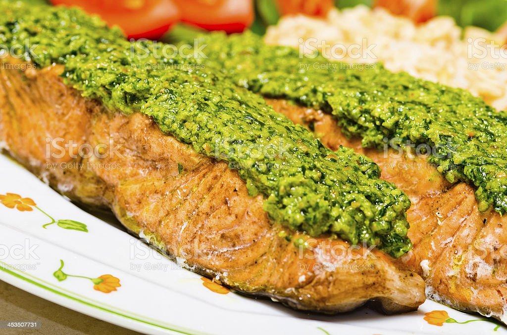 Salmon with pesto stock photo