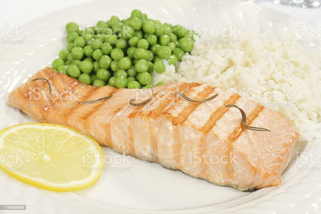 salmon with rosemary and vegetables royalty-free stock photo