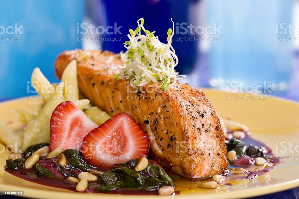 Salmon with Strawberries and Spinach royalty-free stock photo