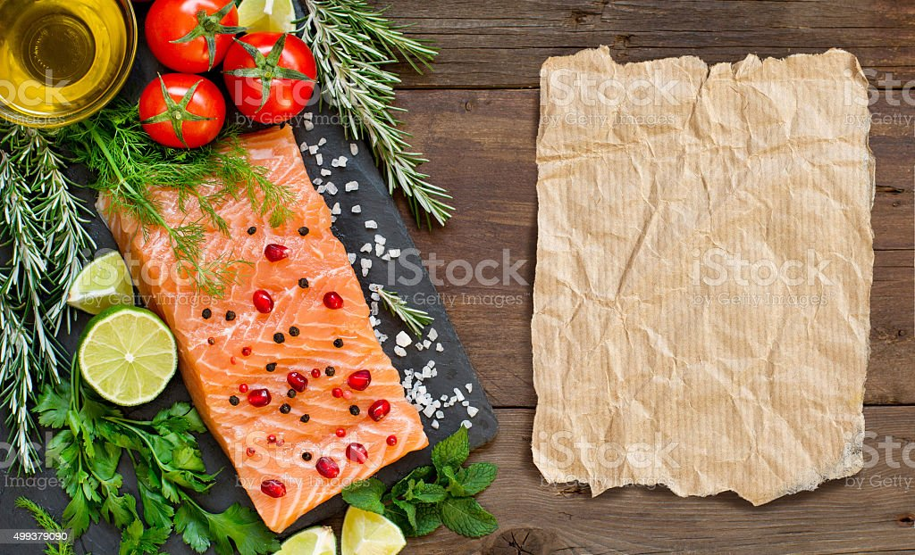 Salmon with vegetables and herbs stock photo