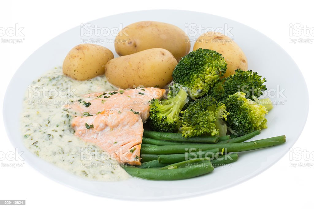 Salmon with watercress sauce and vegetables stock photo