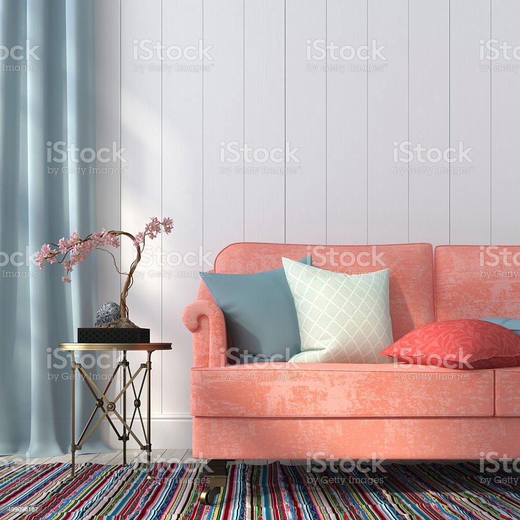 Salmon-colored sofa and a metal table stock photo