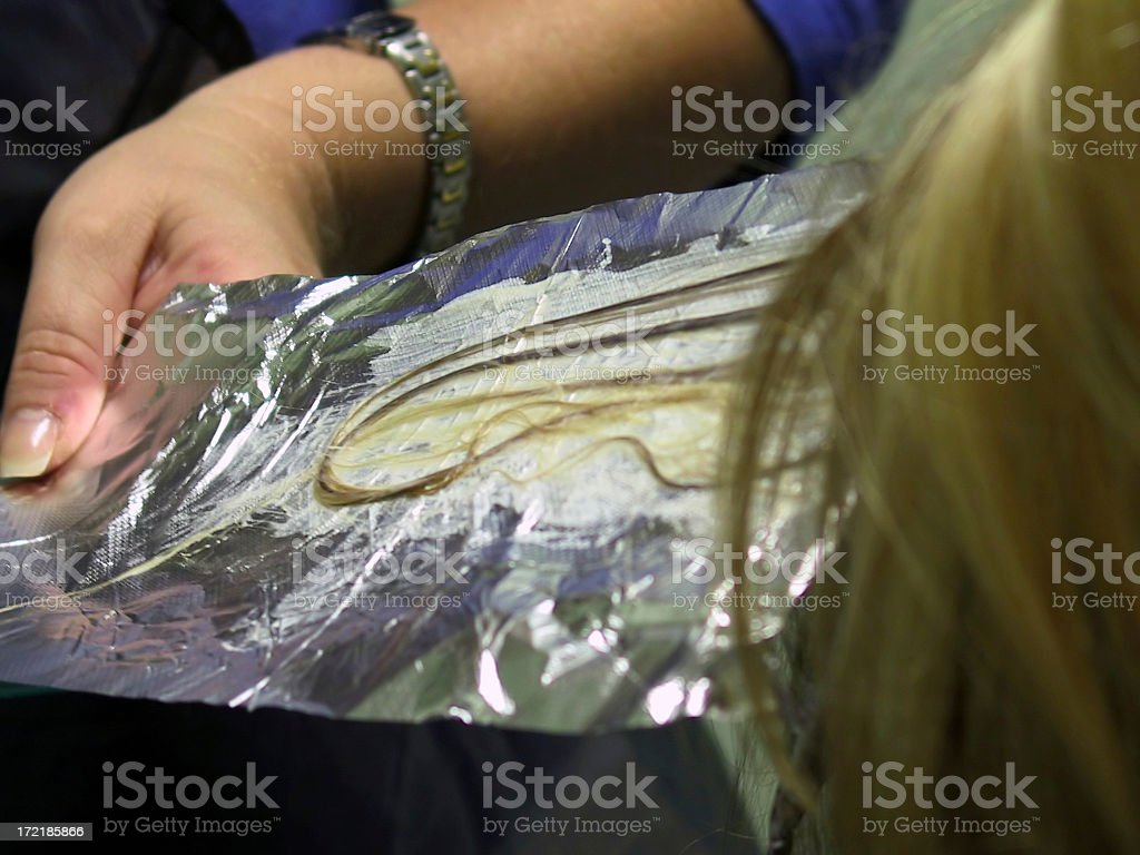 Salon - Foil Hair Highlighting technique royalty-free stock photo
