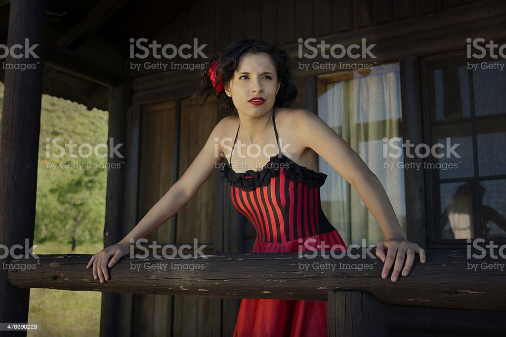 Saloon Girl on the Porch royalty-free stock photo
