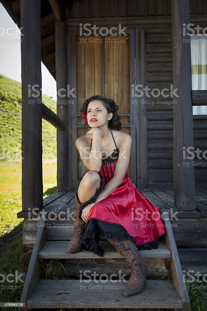 Saloon Girl on the Porch stock photo
