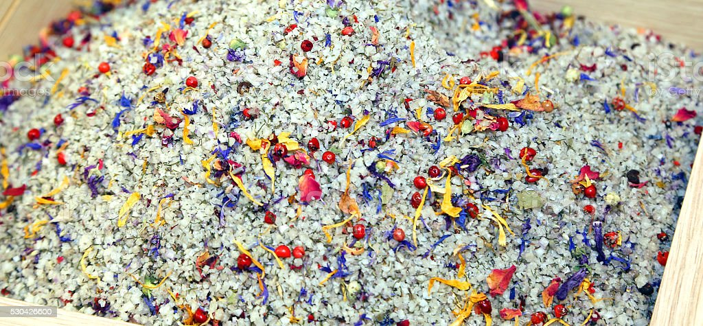 salt and grains of coarse salt with herbs stock photo