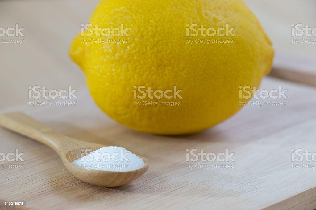 Salt and lemon put on chopping block stock photo