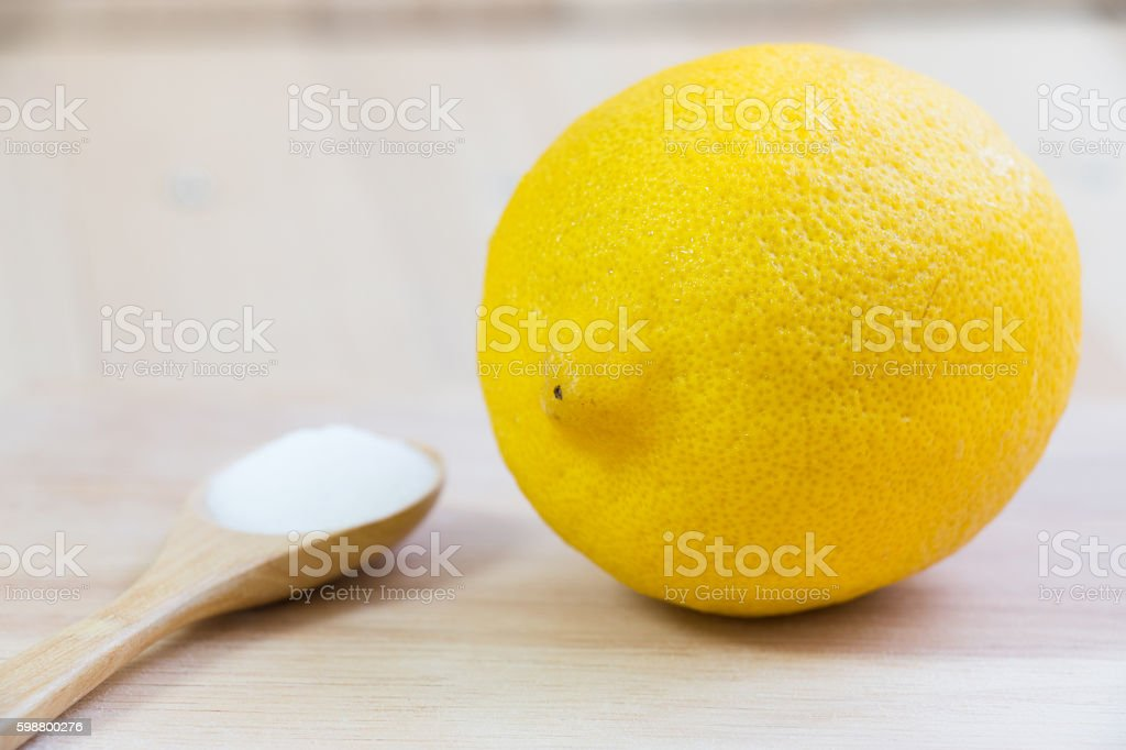 Salt and lemon put on chopping block stock photo