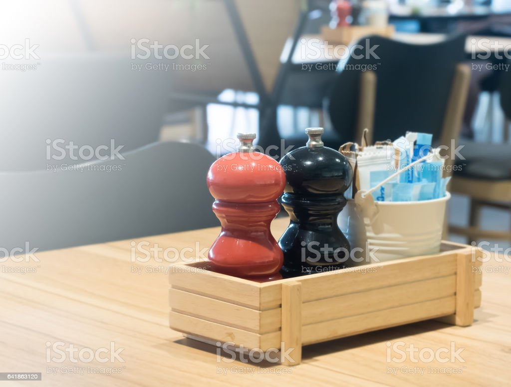 salt and pepper mill on table stock photo
