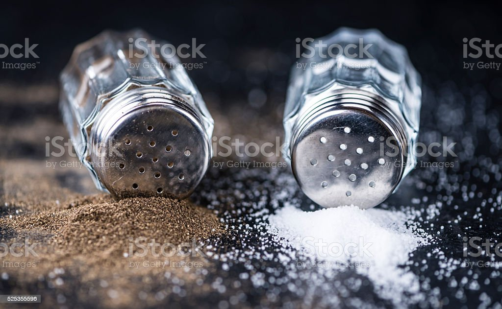 Salt and Pepper Shakers on a slate slab stock photo