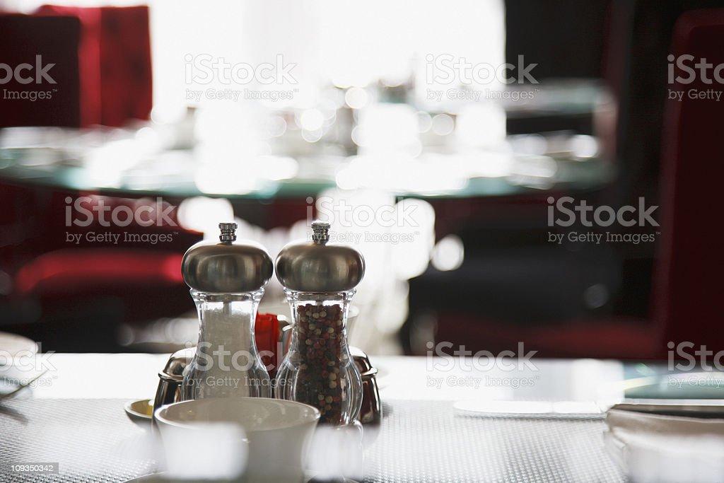 Salt and pepper shakers on restaurant table stock photo