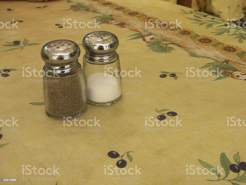 Salt and Pepper Shakers on Table royalty-free stock photo