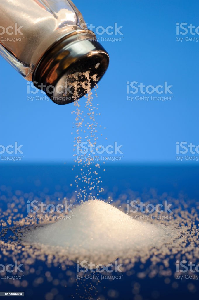 Salt and Shaker on Blue royalty-free stock photo