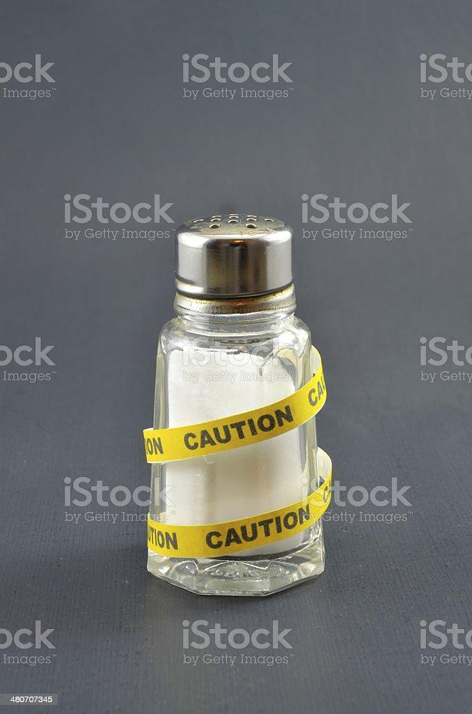 Salt Calls for Caution stock photo