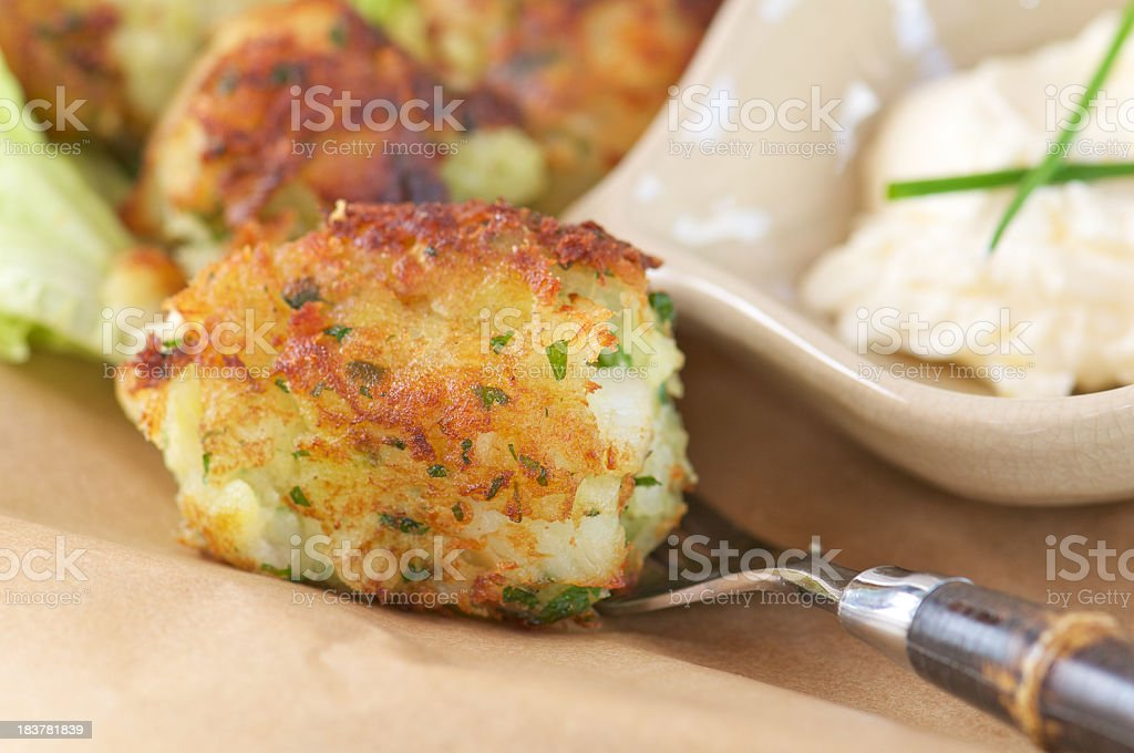 Salt Cod Fritter on Fork with Mayonnaise stock photo