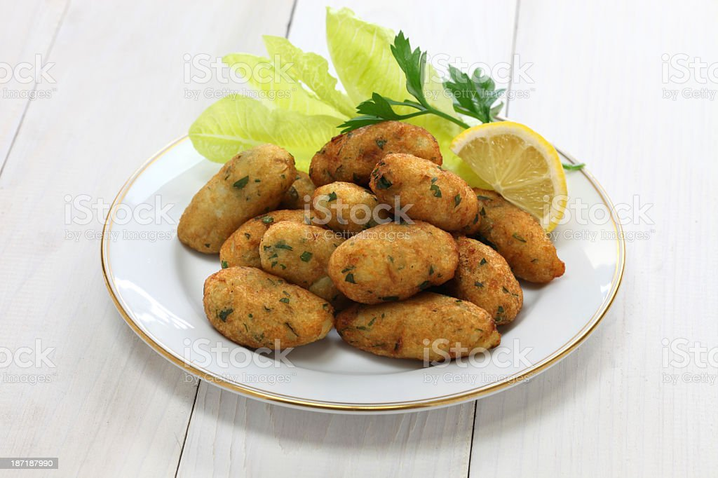 Salt cod fritters and croquettes stock photo