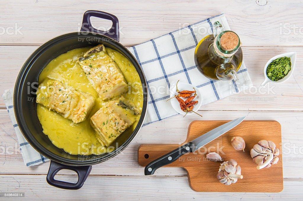 Salt cod in a pilpil sauce stock photo