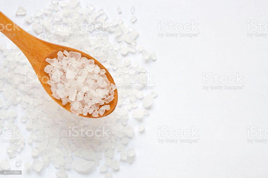 Salt crystals in wooden scoop,selective focus stock photo