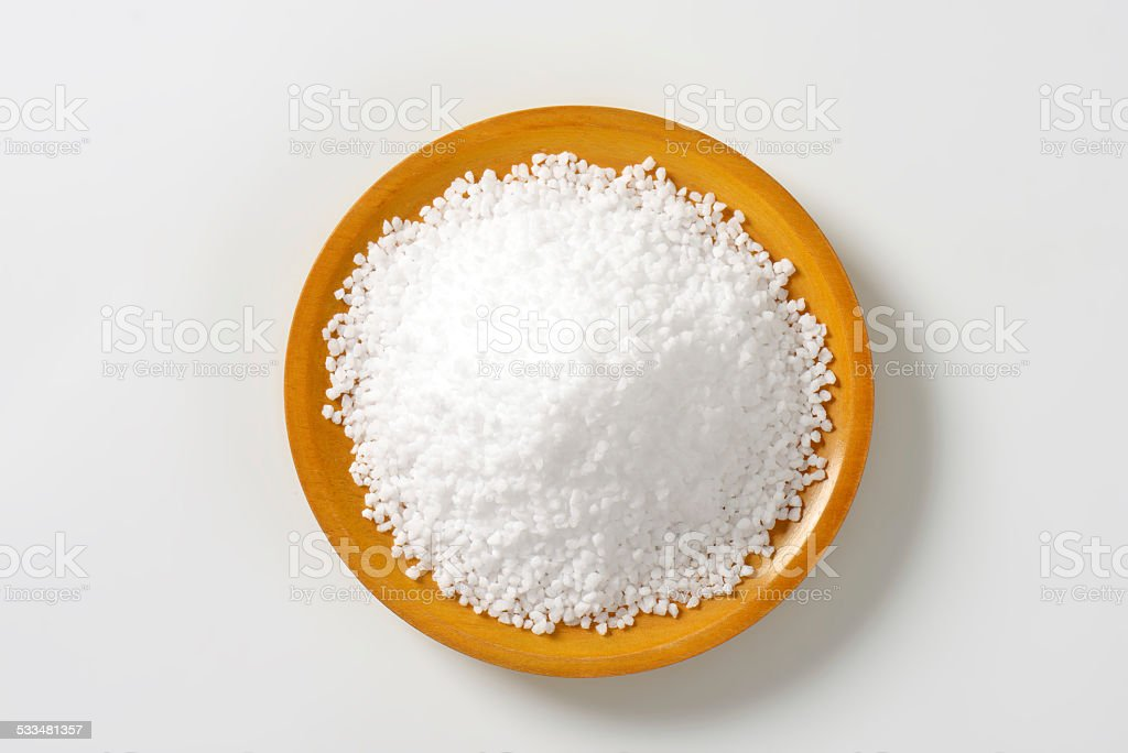 Salt crystals on a plate stock photo