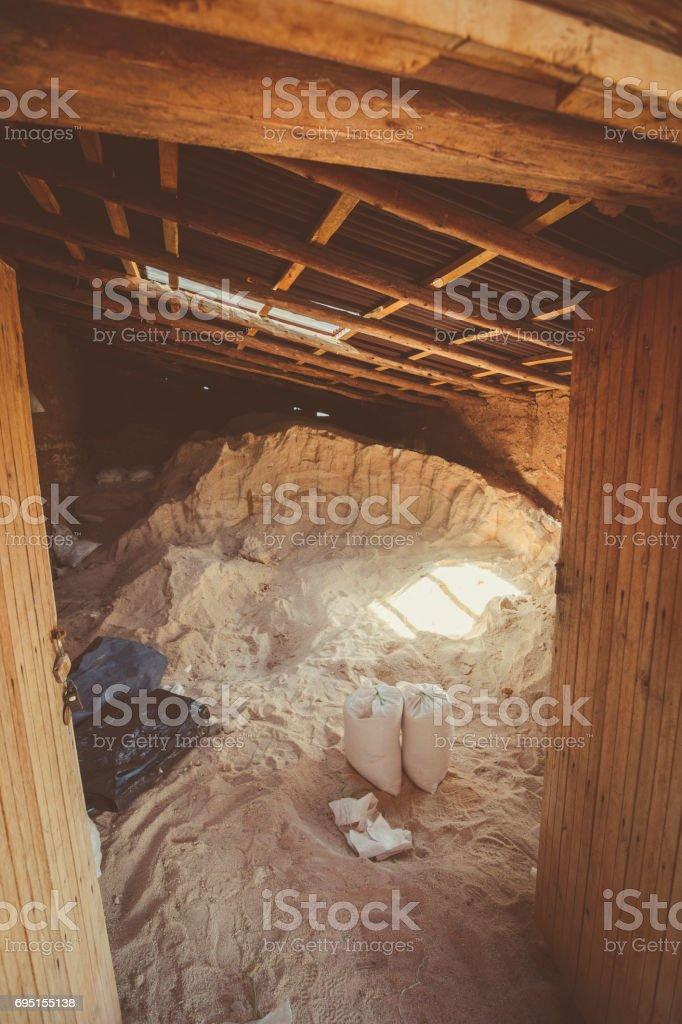 Salt deposited in a dirt built house at Maras salt ponds in Peru's Sacred Valley. stock photo