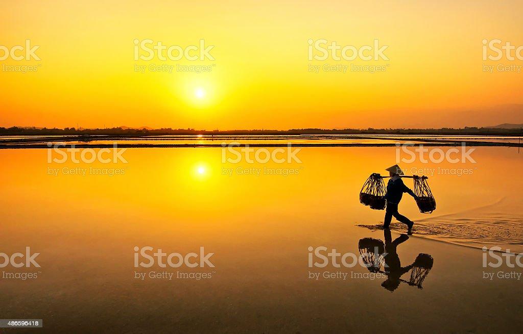 Salt farmer after wholeday working, Hon Khoi,Nha Trang,Vietnam stock photo