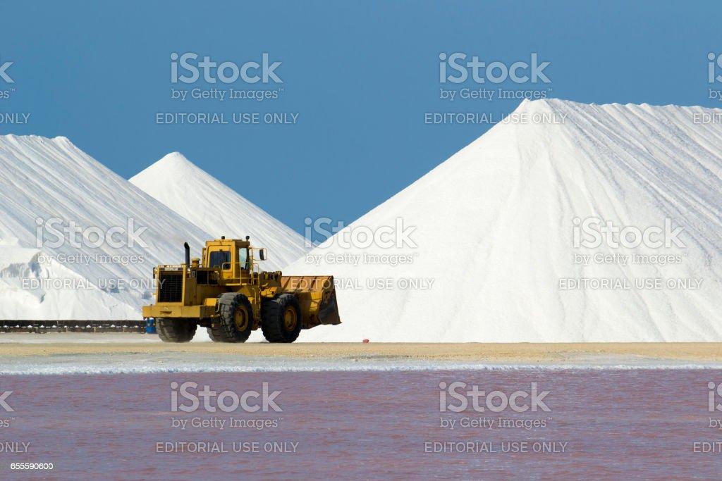 Salt flat and mount and a bulldozer stock photo