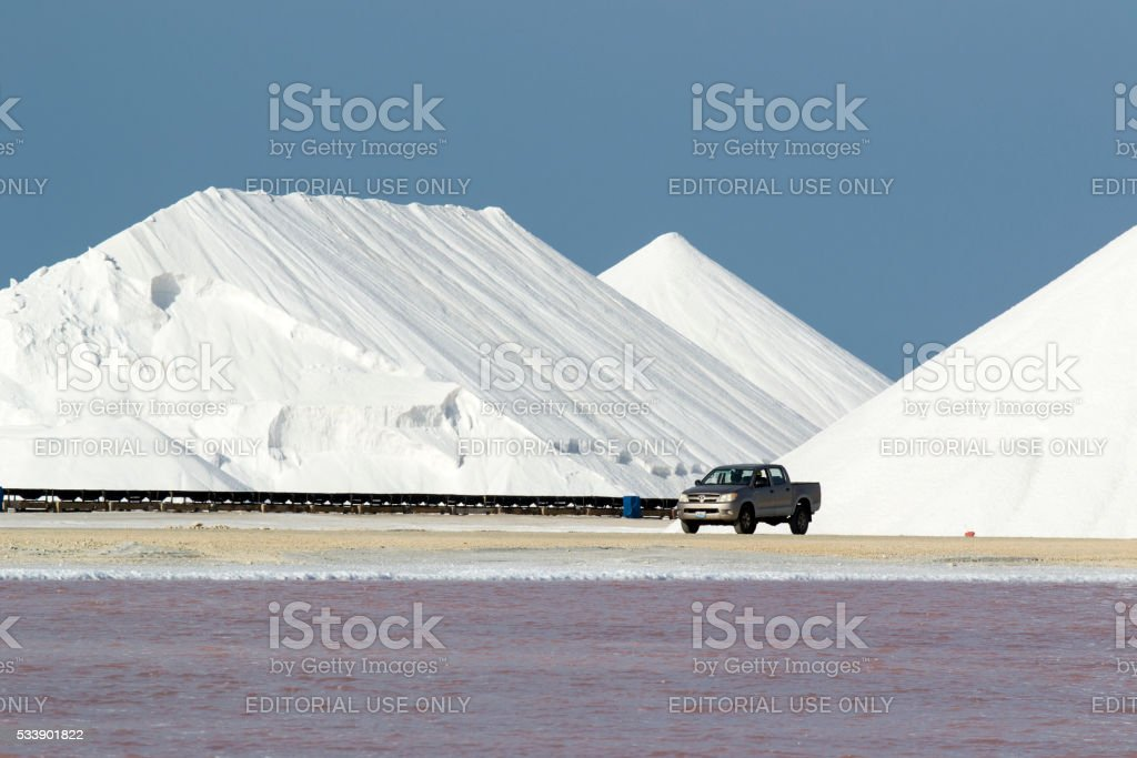 Salt flat and mount and a pick-up stock photo