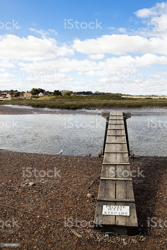 Salt flats, creek and jetty stock photo