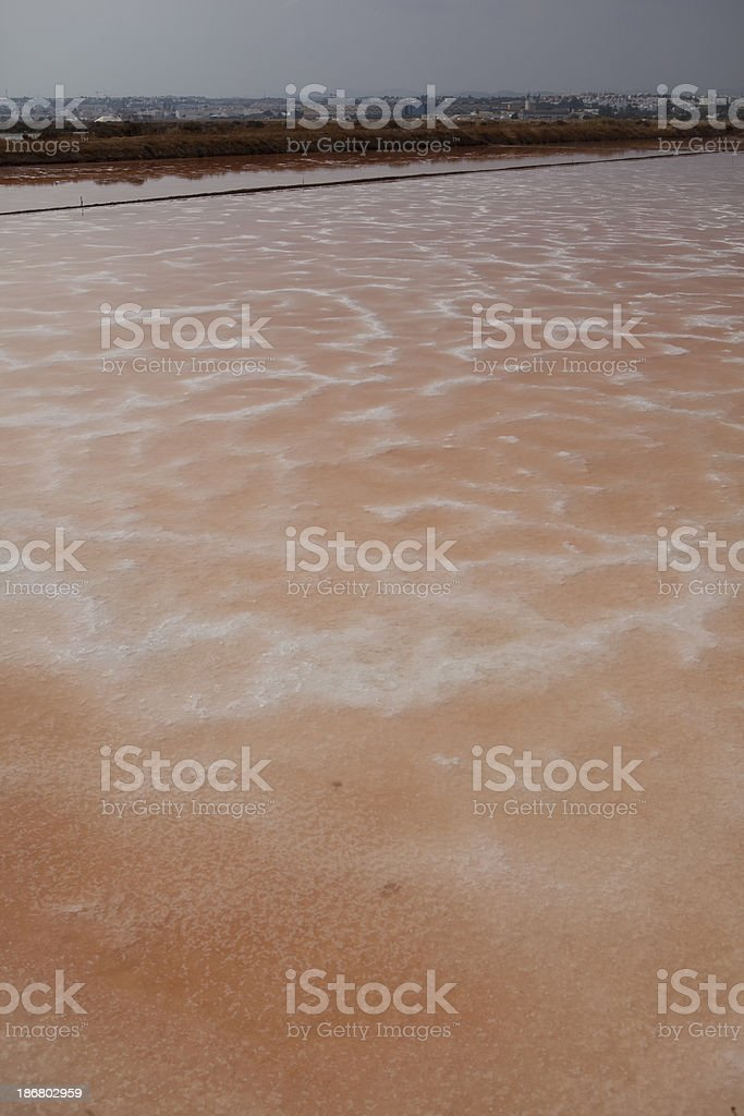 Salt flats outside of Tavira Portugal stock photo