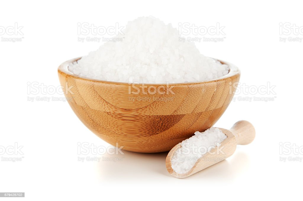 Salt in a bamboo bowl stock photo